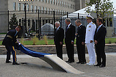 Arlington, VA - September 11, 2008 -- The official party watches as the first inscribed memorial unit is unveiled at the Pentagon Memorial Sept. 11, 2008. The national memorial is the first to be dedicated to those killed at the Pentagon on Sept. 11, 2001. The site contains 184 inscribed memorial units honoring the 59 people aboard American Airlines Flight 77 and the 125 in the building who lost their lives that day. (DoD photo by Cherie Cullen/Released).Credit: DoD via CNP