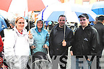 UNDER MY UMBRELLA: Sinead O'Sullivan, Sheila Morris, Patrick O'Sullivan and Sean Harrington from Kenmare taking shelter from the rain at Fair Day in Kenmare on Monday.