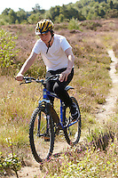 Josh Behr riding Kona mountain bike , Chobham Common, Surrey.   September    2013.      pic copyright Steve Behr / Stockfile
