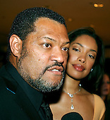 Laurence Fishburne and his wife, Gina Torres, arrive at the Washington Hilton Hotel in Washington, D.C. for the annual White House Correspondents Association (WHCA) dinner on April 29, 2006..Credit: Ron Sachs / CNP