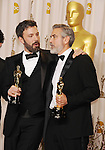 HOLLYWOOD, CA - FEBRUARY 24: Ben Affleck and George Clooney pose in the press room the 85th Annual Academy Awards at Dolby Theatre on February 24, 2013 in Hollywood, California.