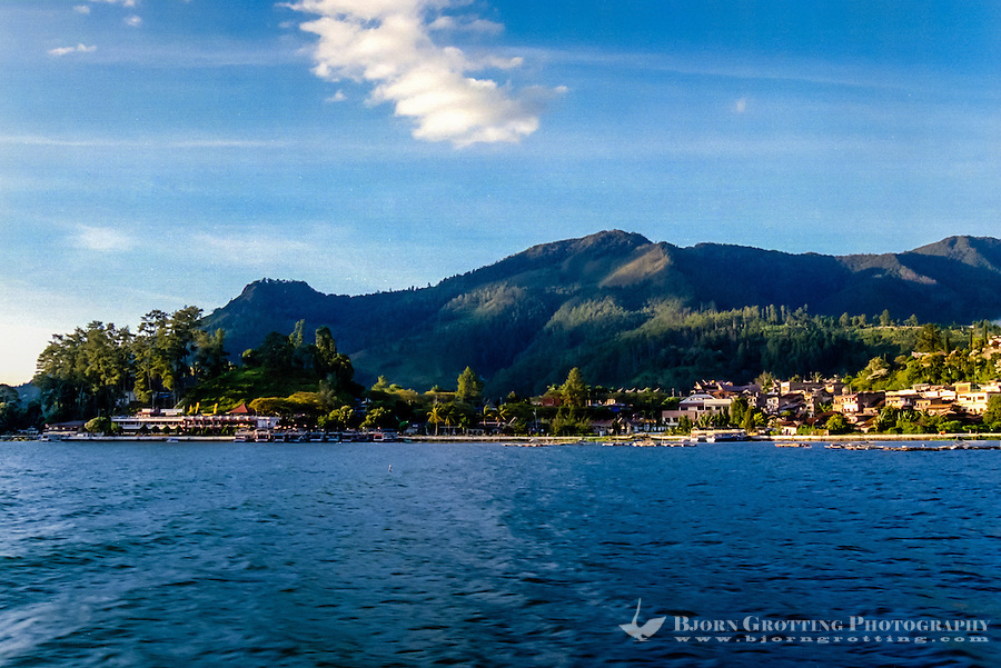 Indonesia, Sumatra. Parapat. Surrounded by hills on one side and the blue lake on the other, Parapat is a popular resort area for rich Indonesians.
