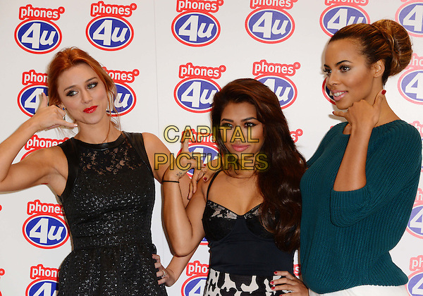 Una Healy, Vanessa White &amp; Rochelle Humes of The Saturdays<br /> Three members of The Saturdays pose for photos and meet fans as they visit phone shop as part of the company's #projectupgrade campaign and unveiled the new iPhone 5S and iPhone 5C. Phones 4U, Oxford Street, London, United Kingdom, September 20th 2013.<br /> half  length black dress leather lace sleeveless green jumper sweater white skirt print hand hands phone gesture pose bustier top<br /> CAP/BF<br /> &copy;Bob Fidgeon/Capital Pictures
