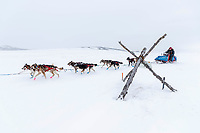 Mike Williams Jr. runs past a tripod trail marker on the trail nearing the Unalakleet checkpoint on Monday  afternoon March 12th during the 2018 Iditarod Sled Dog Race -- Alaska<br /> <br /> Photo by Jeff Schultz/SchultzPhoto.com  (C) 2018  ALL RIGHTS RESERVED