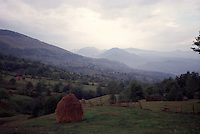 ROMANIA / Maramures / Botiza / September 2002..An evening landscape above the village of Botiza located off the Iza Valley. Maramures is home to the most traditional rural life left in Europe...© Davin Ellicson / Anzenberger