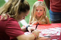 NWA Democrat-Gazette/J.T. WAMPLER Cheyenne Sherman, 4, gets autographs from the Razorback volleyball team Saturday August 12, 2017 during the RazorbacksÕ annual Fan Day at the University of Arkansas. Football players and coaches were available for autographs with the soccer and volleyball teams.