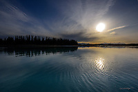 The sun rises over Skilak Lake and the Middle Kenai River, painting a vibrant spring scene during an outing to seek rainbow trout in Alaska's Kenai National Wildlife Refuge.