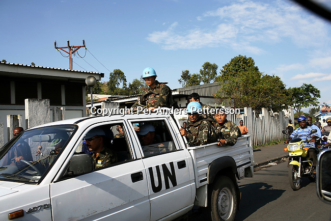 GOMA, DRC OCTOBER 3: Indian United Nations soldiers patrol in a pick up truck on October 3, 2006 in central Goma, DRC. They are part of MONUC, the largest peace keeping force in the world right now. The UN implemented the force after the Lusaka Accord in 1999. This eastern Congolese city has seen a big influx of refugees from neighboring Rwanda after the Genocide in 1994 and a recent volcanic eruption from the Nyiragongo volcano in 2002, which destroyed parts of the city and made many people homeless. .(Photo by Per-Anders Pettersson/Getty Images)...