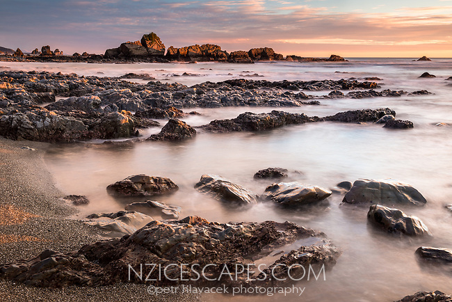 Sunset over rock formations near Rapahoe near Greymouth, Buller Region, West Coast, South Island, New Zealand, NZ