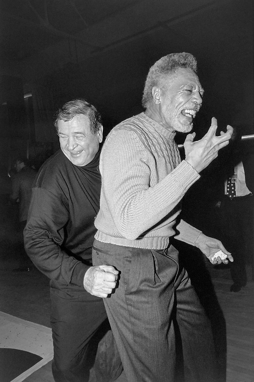 "Rep. Daniel David ""Dan"" Rostenkowski, D-Ill., Chairman of the Ways and Means Committee, and Rep. Ronald Vernie ""Ron"" Dellums, D-Calif., having good time at sock-hop dancing at the Democratic Issues Conference in Baltimore, Maryland at Johns Hopkins. 1993 (Photo by Maureen Keating/CQ Roll Call)"