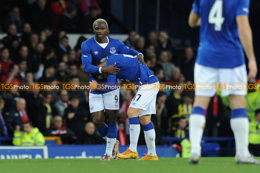 Arouna Kone (left) of Everton celebrates the opening goal during Everton vs Dagenham and Redbridge at Goodison Park