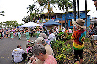 8 year old child wearing Akubra hat, videoing dancers in monthly street market, the Village Stroll, Kailua-Kona, Big Island, Hawaii