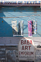 The shutters of Baba's Art Emporium and House of Textiles in the local market remain firmly closed to business