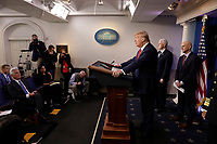 United States President Donald J. Trump speaks during a press briefing on the Coronavirus COVID-19 pandemic with members of the Coronavirus Task Force at the White House in Washington on March 19, 2020.  Standing behind the President are: US Vice President Mike Pence and Stephen Hahn, Commissioner, US Food and Drug Administration (FDA).<br /> Credit: Yuri Gripas / Pool via CNP/AdMedia