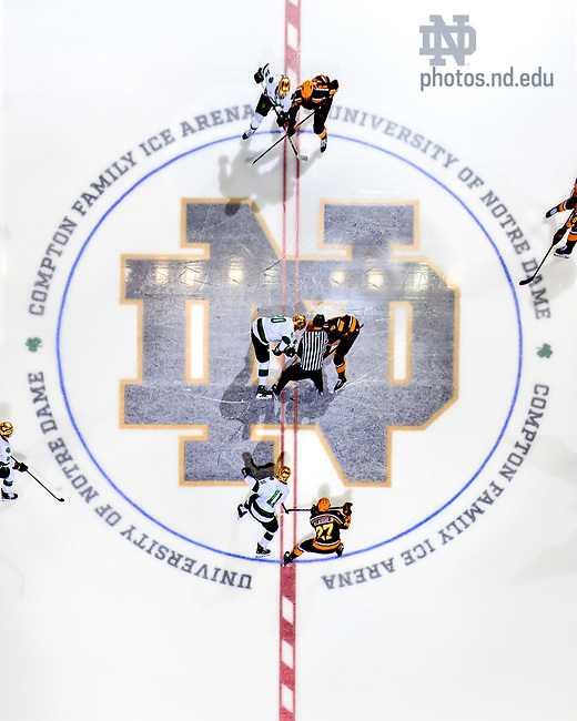 February 15, 2020; Puck drop at a hockey game, 2020. (Photo by Matt Cashore/University of Notre Dame)