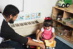 Education Preschool toddler 2s program father plays with his daughter and toy vehicles at the start of the day