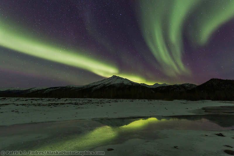 The aurora reflect in the Koyukuk River in Alaska's Arctic.