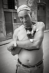 Havana, Cuba: Street scene, man with cat, Old Havana