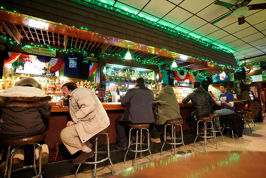 BROOKLYN, NY - JANUARY 15, 2016:  Patrons sit at the bar at Irish Haven, a remnant of a time when Sunset Park was populated by Irish and Scandinavian immigrants, rather than Latin and Chinese.<br /> LOCATION: 4th Avenue and 58th Street. <br /> CREDIT: Clay Williams for the New York Times.<br /> <br /> &copy; Clay Williams / claywilliamsphoto.com