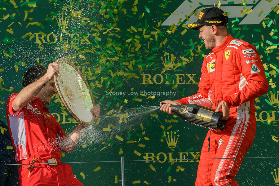 March 25, 2018: Sebastian Vettel (DEU) #5 from the Scuderia Ferrari team celebrates after winning the 2018 Australian Formula One Grand Prix at Albert Park, Melbourne, Australia. Lewis Hamilton (GBR) #44 from the Mercedes AMG Petronas Motorsport team came second and Sebastian Vettel (DEU) #5 from the Scuderia Ferrari team came third. Photo Sydney Low