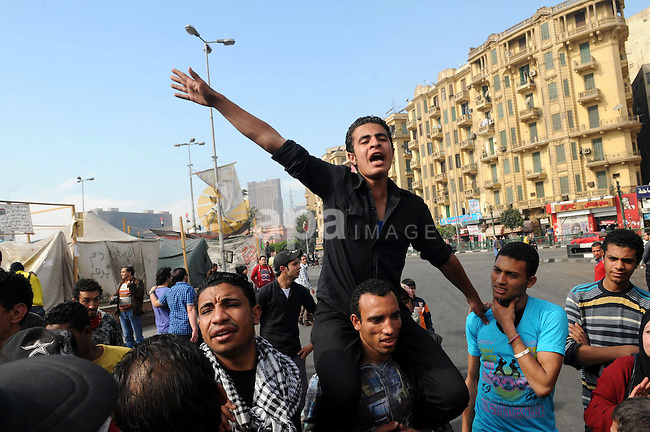 Egyptian protestors shout slogans against Egypt's President during an anti-government demonstration in Cairo's landmark Tahrir square on February 26, 2013. Photo by Tarek al-Gabas