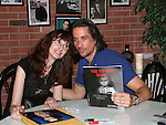 One Life To Live's Michael Easton poses with a fan who shows Michael a book she wrote on July 13, 2008 at Uncle Vinnie's Comedy Club in Point Pleasant, New Jersey. There was entertainment, q & a, and signing of photos and Michael's new book,. a graphic novel (which Melissa is holding) written by Michael and artwork by Christopher Shy. (Photo by Sue Coflin/Max Photos)
