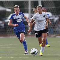 Portland Thorns FC midfielder Tobin Heath (17) on the attack as Boston Breakers midfielder Joanna Lohman (11) closes. In a National Women's Soccer League (NWSL) match, Portland Thorns FC (white/black) defeated Boston Breakers (blue), 2-1, at Dilboy Stadium on July 21, 2013.