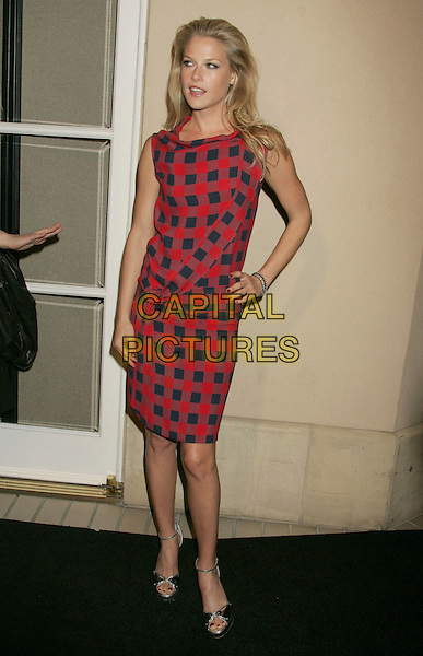 ALI LARTER.ELLE Magazine's 14th Annual Women in Hollywood held at the Four Seasons Hotel,  Beverly Hills, California, USA.October 15th, 2007.full length red and blue checked print dress squares tartan plaid gingham silver shoes sandals hand on hip .CAP/ADM/RE.©Russ Elliot/AdMedia/Capital Pictures.