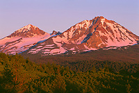 USA, Oregon, Deschutes National Forest, Sunrise reddens Middle Sister (left) and North Sister (right) in the Three Sisters Wilderness.