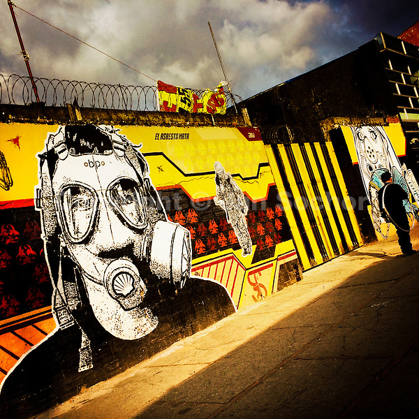 A Colombian man passes in front of a graffiti stencil artwork, created by an artist named Dj Lu, in the center of Bogotá, Colombia, 19 February, 2016. A social environment full of violence and inequality (making the street art an authentic form of expression), with a surprisingly liberal approach to the street art from Bogotá authorities, have given a rise to one of the most exciting and unique urban art scenes in the world. While it's technically not illegal to scrawl on Bogotá's walls, artists may take their time and paint in broad daylight, covering the walls of Bogotá not only in territory tags and primitive scrawls but in large, elaborate artworks with strong artistic style and concept. Bogotá has become an open-air gallery of contemporary street art.