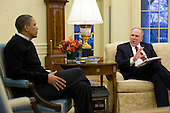 Washington, DC - January 4, 2010 -- United States President Barack Obama meets with John Brennan, Deputy National Security Advisor for Counterterrorism and Homeland Security, in the Oval Officeof the White House in Washington, D.C., Monday, January 4, 2010..Mandatory Credit: Pete Souza - White House via CNP