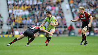 Ben Foden of Northampton Saints hands off Marcelo Bosch of Saracens during the Aviva Premiership Final between Saracens and Northampton Saints at Twickenham Stadium on Saturday 31st May 2014 (Photo by Rob Munro)