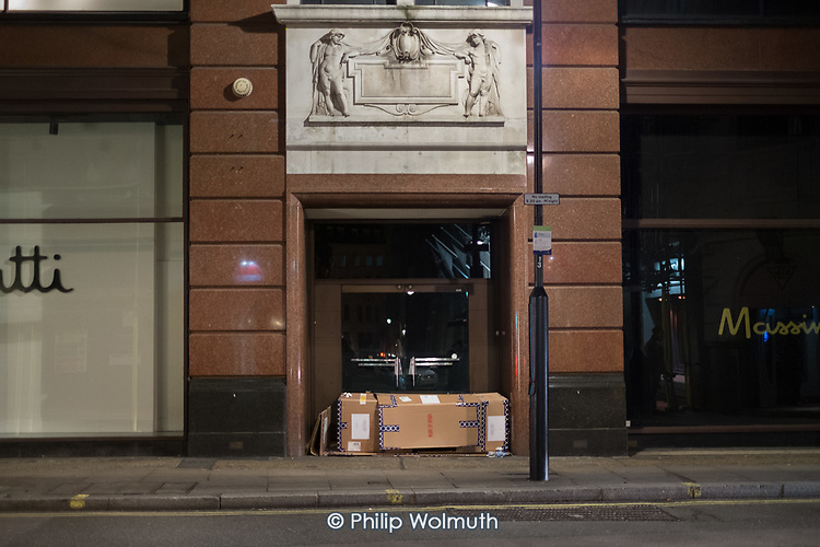 Rough sleeper in the doorway of Massimo Dutti clothing store, Beak Street, London.