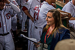 6 October 2017: Washington Nationals Senior Director of Communications Amanda Comak smiles in the dugout as she prepares for the formal team introductions prior to the NLDS Game 1 against the Chicago Cubs at Nationals Park in Washington, DC. The Cubs shut out the Nationals 3-0 to take a 1-0 lead in their best of five Postseason series. Mandatory Credit: Ed Wolfstein Photo *** RAW (NEF) Image File Available ***