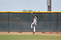 AZL Indians Red right fielder Jean Montero (15) catches a fly ball during an Arizona League game against the AZL Indians Blue on July 7, 2019 at the Cleveland Indians Spring Training Complex in Goodyear, Arizona. The AZL Indians Blue defeated the AZL Indians Red 5-4. (Zachary Lucy/Four Seam Images)