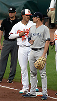 Baltimore Orioles shortstop Manny Machado (13) converses with New York Yankees first baseman Greg Bird (33) after reaching base on a single in the first inning at Oriole Park at Camden Yards in Baltimore, MD on Tuesday, July 10, 2018.<br /> Credit: Ron Sachs / CNP<br /> (RESTRICTION: NO New York or New Jersey Newspapers or newspapers within a 75 mile radius of New York City) Credit: Ron Sachs/MediaPunch