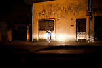 A couple is found kissing late at night in Zone 1, Guatemala City, Guatemala, on Thursday, Nov. 3, 2011.