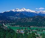 A snow-covered Longs Peak in RMNP above MacGregor Ranch, a historic working cattle ranch, in Estes Park, Colorado, USA