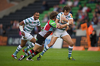 130712 Copyright onEdition 2012 ©.Free for editorial use image, please credit: onEdition..Alex Gray of London Irish is tackled by Luke Wallace of Harlequins at The Stoop, Twickenham in the first round of The J.P. Morgan Asset Management Premiership Rugby 7s Series...The J.P. Morgan Asset Management Premiership Rugby 7s Series kicked off again for the third season on Friday 13th July at The Stoop, Twickenham with Pool B being played at Edgeley Park, Stockport on Friday, 20th July, Pool C at Kingsholm Gloucester on Thursday, 26th July and the Final being played at The Recreation Ground, Bath on Friday 3rd August. The innovative tournament, which involves all 12 Premiership Rugby clubs, offers a fantastic platform for some of the country's finest young athletes to be exposed to the excitement, pressures and skills required to compete at an elite level...The 12 Premiership Rugby clubs are divided into three groups for the tournament, with the winner and runner up of each regional event going through to the Final. There are six games each evening, with each match consisting of two 7 minute halves with a 2 minute break at half time...For additional images please go to: http://www.w-w-i.com/jp_morgan_premiership_sevens/..For press contacts contact: Beth Begg at brandRapport on D: +44 (0)20 7932 5813 M: +44 (0)7900 88231 E: BBegg@brand-rapport.com..If you require a higher resolution image or you have any other onEdition photographic enquiries, please contact onEdition on 0845 900 2 900 or email info@onEdition.com.This image is copyright the onEdition 2012©..This image has been supplied by onEdition and must be credited onEdition. The author is asserting his full Moral rights in relation to the publication of this image. Rights for onward transmission of any image or file is not granted or implied. Changing or deleting Copyright information is illegal as specified in the Copyright, Design and Patents Act 1988. If you are in any way unsure of your right to publish this image