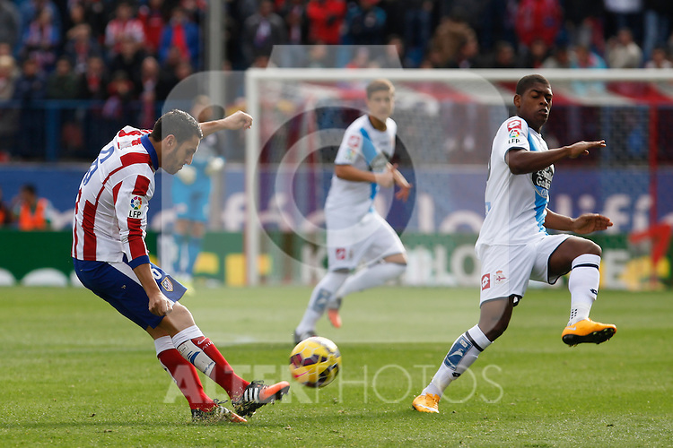 Atletico de Madrid´s Koke (L) and Deportivo de la Coruña´s Cavareiro during 2014-15 La Liga match between Atletico de Madrid and Deportivo de la Coruña at Vicente Calderon stadium in Madrid, Spain. November 30, 2014. (ALTERPHOTOS/Victor Blanco)