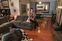 STAFF PHOTO ANTHONY REYES &bull; @NWATONYR<br /> Elizabeth Prenger, director of outreach for First Tee of NW Arkansas, in her favorite space, her living room and dining room Monday, Sept. 22, 2014 at her home in Fayetteville. Prenger and her husband often entertain.
