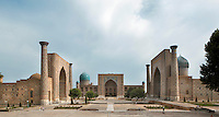 "General view of Registan Square, showing the Sher-Dor, 1619-36, (right), Tillyah-Kori, 1646-60, (centre) and Ulugh Beg, 1417-20, (left) Madrasahs, Samarkand, Uzbekistan, pictured on July 16, 2010, in the morning. The Tillyah-Kori (gilded) Madrasah is part of the Registan Ensemble, surrounding a magnificent square. Commissioned by Yalangtush Bakhadur it is not only a school but also the grand mosque whose lavishly gilded main hall in Kundal style justifies the name. The 75 metre main facade is two-storied with corner turrets.  The dome was only completed during the 20th century Soviet restoration. The Sher-Dor Madrasah, commissioned by Yalangtush Bakhodur as part of the Registan ensemble, and designed by Abdujabor, takes its name, ""Having Tigers"", from the double mosaic (restored in the 20th century) on the tympans of the portal arch showing suns and tigers attacking deer. The lancet arched portal of this Madradsah, commissioned by the scholarly Ulugh Beg, faces the square and high well-proportioned minarets flank the corners. Geometrically patterned mosaic surroun Samarkand, a city on the Silk Road, founded as Afrosiab in the 7th century BC, is a meeting point for the world's cultures. Its most important development was in the Timurid period, 14th to 15th centuries. Picture by Manuel Cohen."