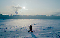 St Petersburg, Russia, January 2003..Petersburgers make the most of the city's famous parks and waterways at any time of the year - taking a short cut across the frozen River Neva in temperatures of -30C.