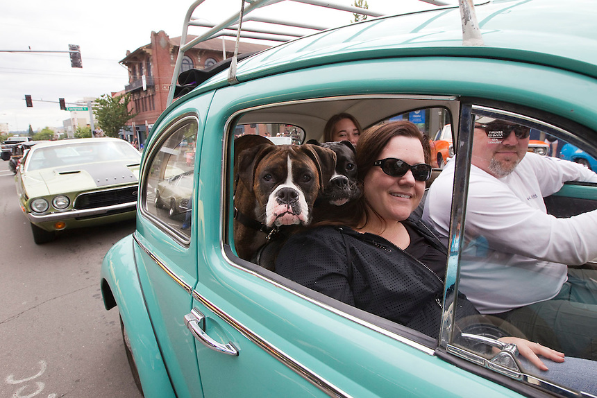 """Susan Schrantz takes part in """"Crusin' the Gut"""" with her family in a VW Bug on Main Street in downtown Vancouver Saturday July 16, 2016. """"Cruisin' the Gut""""  is an annual event in which antique car enthusiasts drive up and down main street,. (Photo by Natalie Behring/ for the The Columbian)"""
