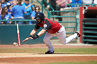Tanner Gardner (27) of the Hickory Crawdads starts his slide into home plate during the game against the Charleston RiverDogs at L.P. Frans Stadium on May 13, 2019 in Hickory, North Carolina. The Crawdads defeated the RiverDogs 7-5. (Brian Westerholt/Four Seam Images)