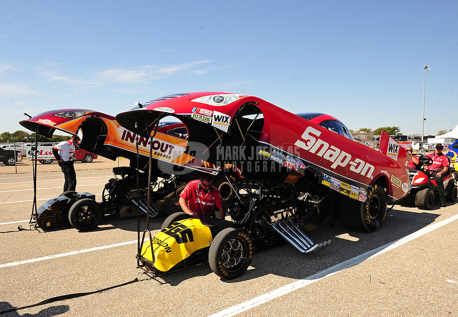 Sept. 25, 2011; Ennis, TX, USA: The cars of NHRA funny car driver Cruz Pedregon (near) and Melanie Troxel during the Fall Nationals at the Texas Motorplex. Mandatory Credit: Mark J. Rebilas-
