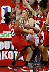 VERMILLION, SD - MARCH 27, 2016 -- Margaret McCloud #30 of South Dakota tries to pass the ball while defended by Kayla Smith #32 of Western Kentucky during their WNIT game Sunday evening at the Dakotadome in Vermillion, S.D.  (Photo by Dick Carlson/Inertia)
