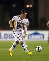 Pumas UNAM forward Juan Carlos Cacho (11) passes the ball. The New England Revolution defeated Pumas UNAM in SuperLiga group play, 1-0, at Gillette Stadium on July 14, 2010.