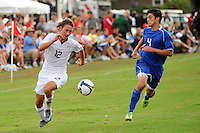 Andrew Craven (12) of the USA is defended by Dylan Serrano (4) of the Academy Select Team. The US U-17 defeated the Academy Select team 3-1 during day one of the US Soccer Development Academy  Spring Showcase in Sarasota, FL, on May 22, 2009.