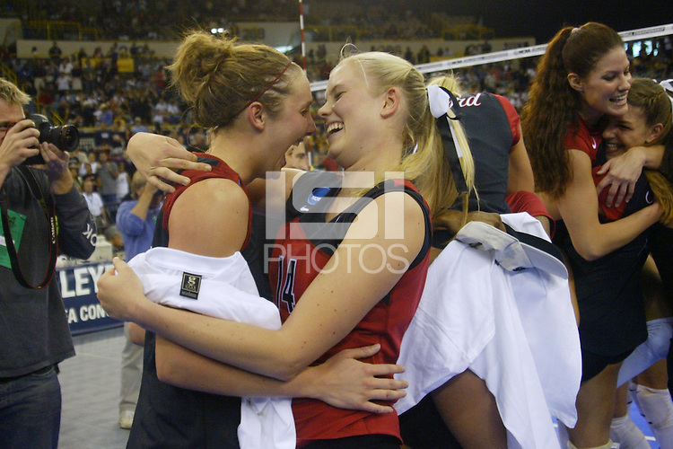 18 December 2004: Stanford Cardinal Courtney Schultz with Kristin Richards during Stanford's  30-23, 30-27, 30-21 victory over Minnesota in the 2004 NCAA Women's Volleyball National Championships in Long Beach, CA. Stanford won their sixth women's volleyball title in school history. Jennifer Hucke and Liz Suiter in the backround.<br />Photo credit mandatory: David Gonzales